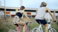 Young couple having fun on bicycleride video