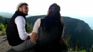 Young couple having fun on hiking video