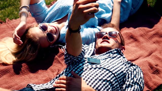 Young couple having fun relaxing in the sun video