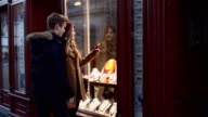 Young couple having fun shopping in the city video