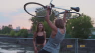 Young couple having fun with their bikes video