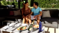 Young couple having lunch outdoors. video
