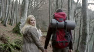 Young couple hiking video
