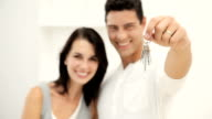 Young Couple Holding New House Keys video