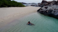 Young couple hugging and kissing at tropical beach, Virgin Gorda video