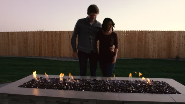 Young Couple in Back Yard at Outdoor Fireplace video