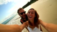 Young couple in Byron Bay-australia take selfie portrait video