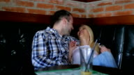 young couple in cafe video