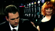 HD CLOSE UP: Young couple in casino video