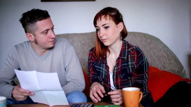 Young couple in Financial Difficulties video