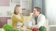 Young couple in kitchen video