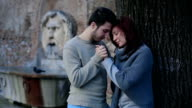 young couple in love in Rome: engagement, caresses, hugs, romantic partners video