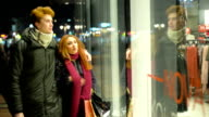Young couple in shopping video