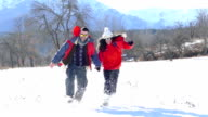 Young couple in snow mountain-slowmotion video
