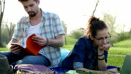 Young couple in the park enjoying a sunny day together video