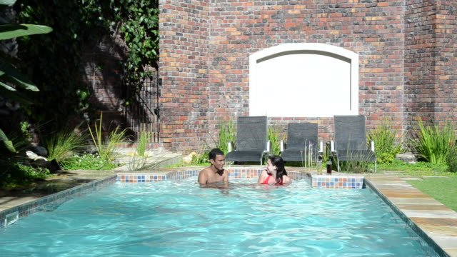 Young couple in the pool video