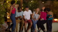 Young couple joined by their friends at a party video