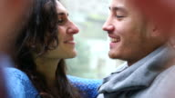 Young couple kissing and laughing video