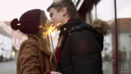SLO MO Young couple kissing with the sparkler video