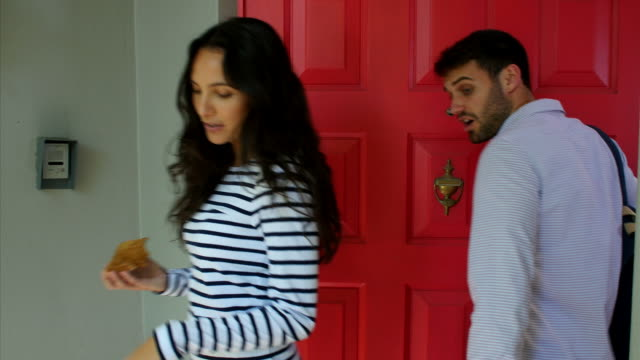 Young Couple Leaving Home For Work Together video