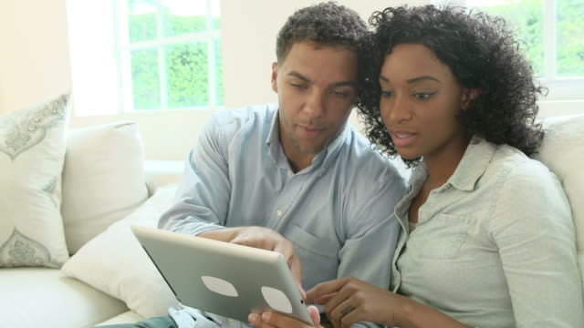 Young Couple Making Online Purchase Using Digital Tablet video