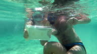 Young Couple Making Selfie Underwater video