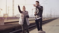 Young couple on a railroad station video