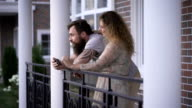 Young couple on a terrace of the house video