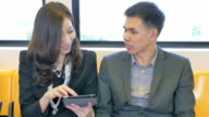 Young couple on train Using digital tablet,Close-up video