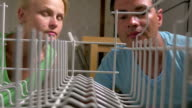 Young couple opens the dishwasher and loads there dishes video