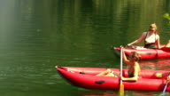 Young couple paddling in a canoe video