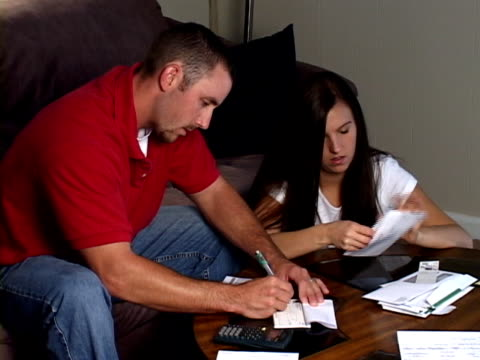 Young Couple Paying Bills video