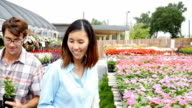 Young couple pick out flowers for their flowerbed video