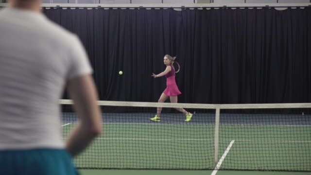 Young couple playing tennis video