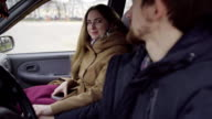 Young couple reconciled in the car video