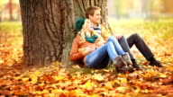 Young couple relaxing in park. video