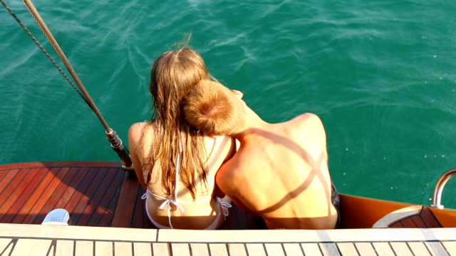 Young couple relaxing on a yacht video