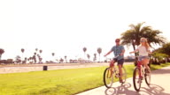 Young Couple Riding Bikes At Beach, Summer Lifestyle HD video
