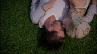 Young couple roll around in a park video