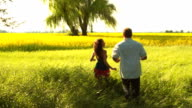Young couple runs out to field video