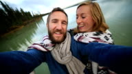 Young couple selfie by the lake video