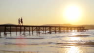 Young Couple silhouette Wwalking on Pier Romantic Concept HD video