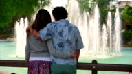 Young couple standing in front of fountain video
