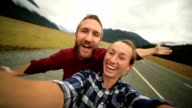 Young couple take selfie portrait with mountain landscape video