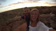 Young couple take selfie portrait with spectacular landscape at sunrise-4K video