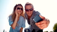 Young couple taking a selfie on a mobile video