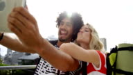 Young couple taking a selfie with digital tablet video