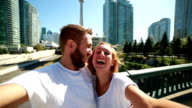 Young couple taking selfie portrait in Toronto-Summer video