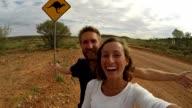 Young couple taking selfie with kangaroo sign, Australia video