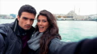 Young Couple Taking Selfies Near The Sea In City video